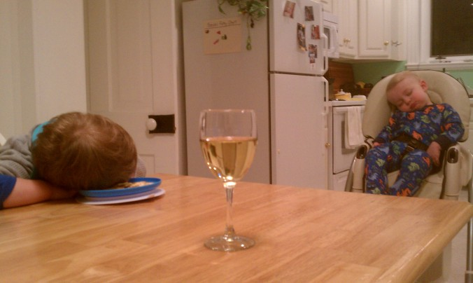 Boys asleep wine on table