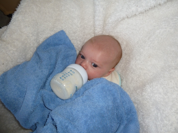 Poor, neglected third baby gets most of his bottles this way.