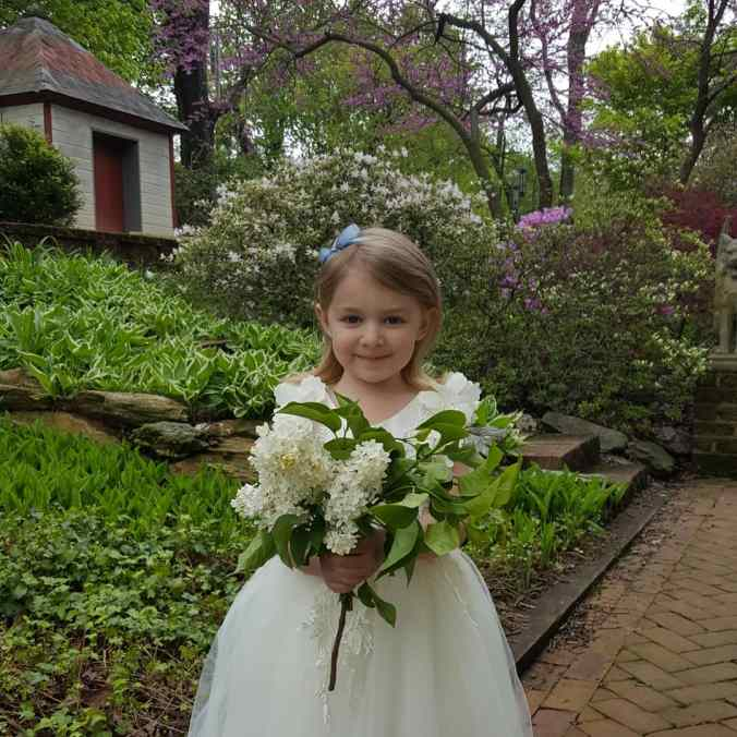 The author's daughter in a flower girl dress